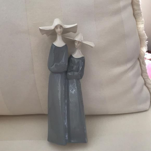 101/2 inch porcelain Nuns statue